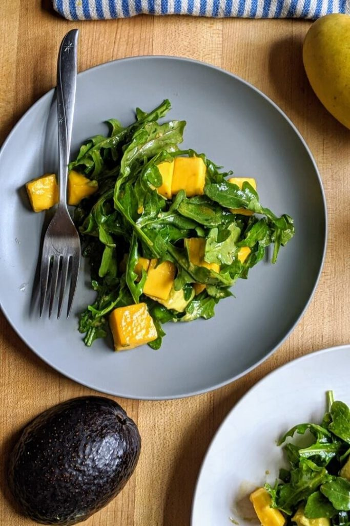 arugula, mango, and avocado salad meal