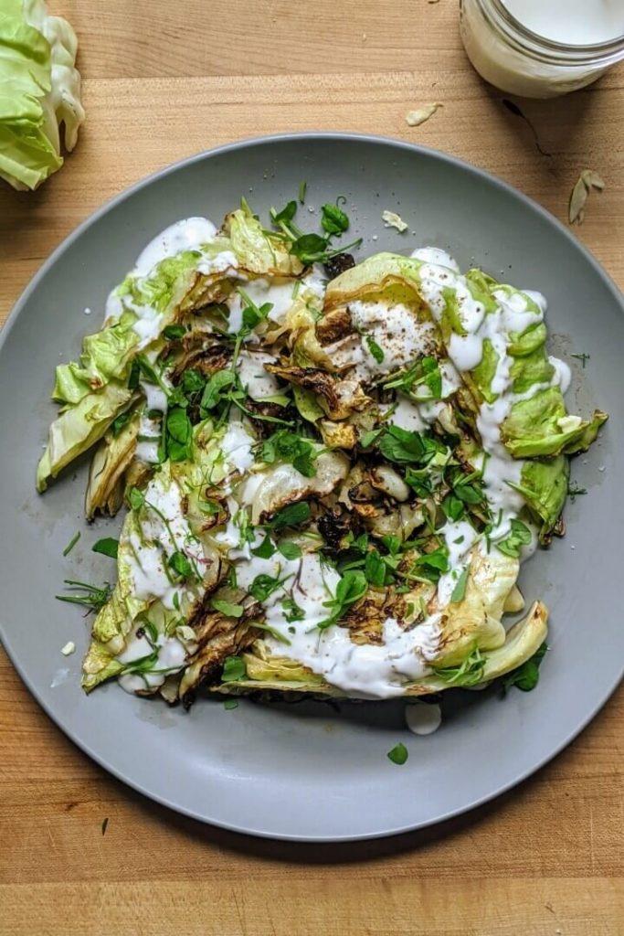 charred cabbage wedges with garlic yogurt sauce